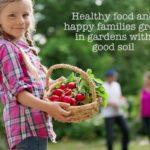 Girl holding basket of radishes.